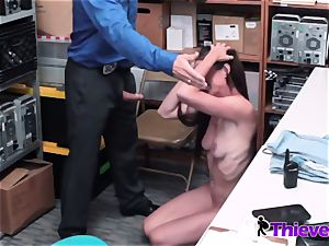 Sofie is positioned on her knees to inhale officers cock when caught stealing