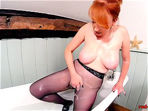 red gonzo playing with her pussy while in stocking