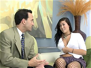 London poked on a couch in fishnet stocking