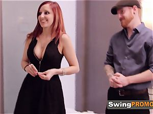 ginger-haired couple gets prepared to party in the crimson apartment with other swingers