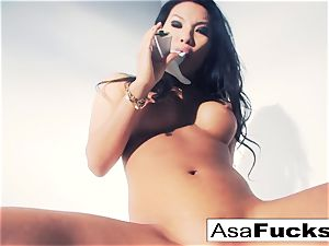 Asa Akira uses a fake arm to satisfy her snatch